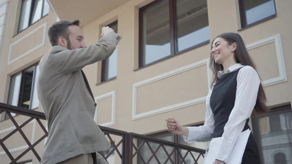 Thumbnail for Cute Young Woman and Confident Man in Formal Wear High Five Together on the Terrace. Business