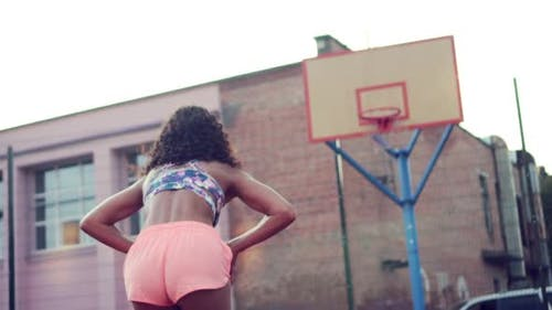 The Woman Plays Basketball