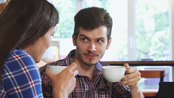 Thumbnail for Shot of a Handsome Man Having Coffee with His Girlfriend