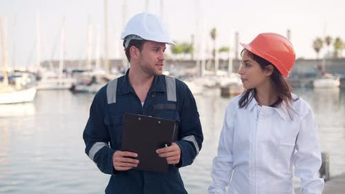 Workers Communicating During Workday in Marina