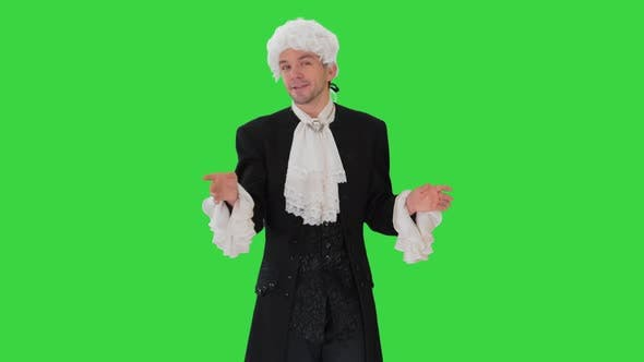 Thumbnail for Man in Old-fashioned Frock Coat and White Wig Talking and Waiving with His Hands Theatrically