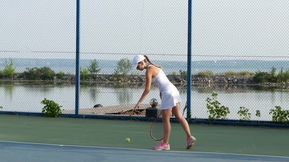 Thumbnail for Women Playing Tennis. Player Serving Tennis Ball with Tennis Racket