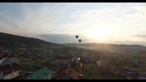 Thumbnail for Two Balloons Are Flying To Meet the Sunset. Aerial View