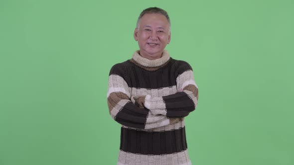 Thumbnail for Happy Mature Japanese Man Smiling with Arms Crossed Ready for Winter