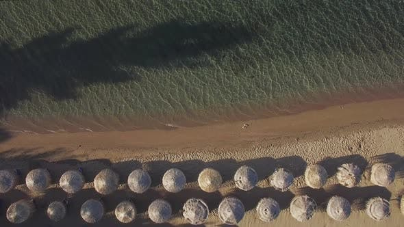 Thumbnail for Aerial Vacation Scene of Sea and Beach with Straw Umbrellas