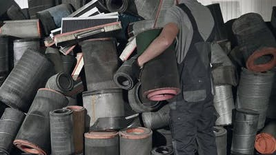 Trucks Mechanic and the Pile of Used Air Filters