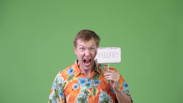 Thumbnail for Young Handsome Tourist Man Screaming with Selfie Paper Sign