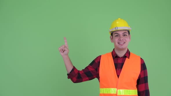 Thumbnail for Happy Young Multi Ethnic Man Construction Worker Talking While Pointing Up