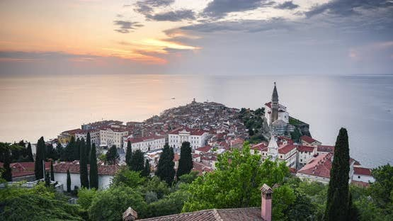 Timelapse of Slovenia at Piran old town with Mediterranean Sea and traditional red rooftops. Elevate