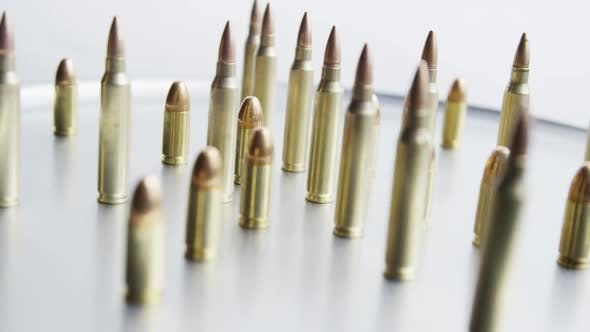 Thumbnail for Cinematic rotating shot of bullets on a metallic surface - BULLETS 081