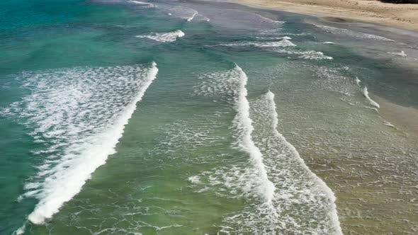 Aerial View To Tropical Sandy Beach and Blue Ocean.