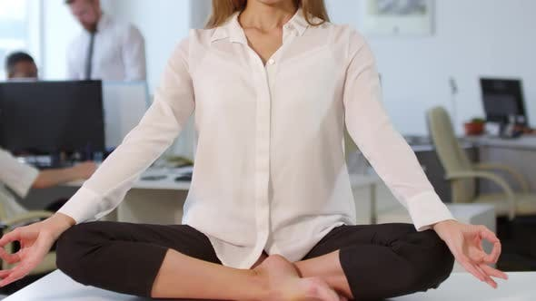 Thumbnail for Office Worker Meditating in Office