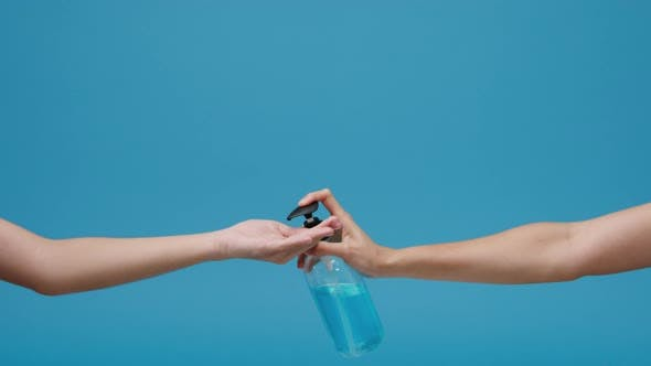 Young Asian girl using alcohol gel hand sanitizer wash hand for protect coronavirus isolated.