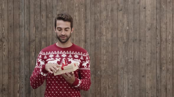 Thumbnail for Christmas Jumper Guy Gets A Gift