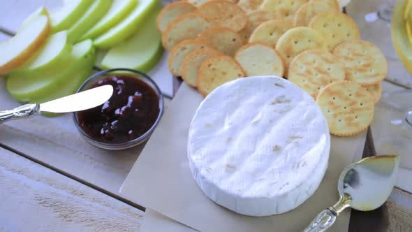 Thumbnail for Brie cheese and cracker appetizer for  party table.