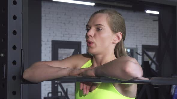 Thumbnail for Young Beautiful Sportswoman Resting at the Gym After Exercising