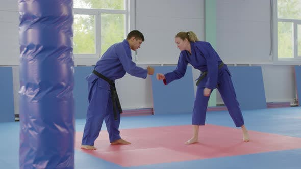 Thumbnail for Male and Female Jujitsu Athletes Greeting Each Other and Preparing for Fight