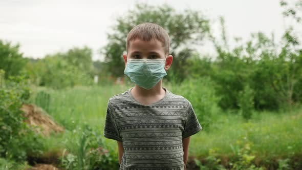 Little child with protective mask