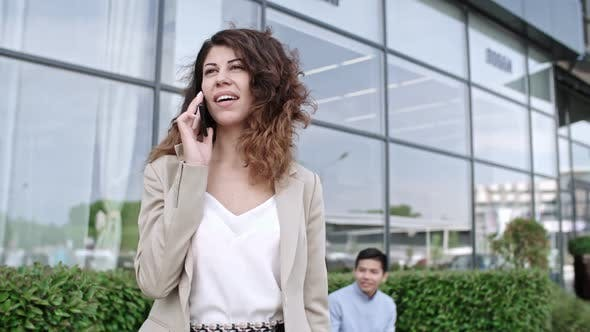 Cover Image for Pretty Lady Standing on Street in Downtown and Talking on Phone