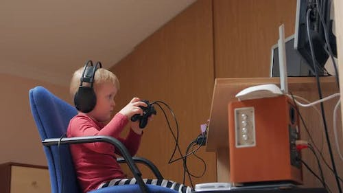Little Boy Playing With Joystick