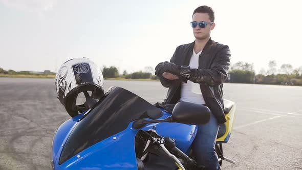 Thumbnail for Motorcyclist Who Sits on a Motorcycle in Sunglasses