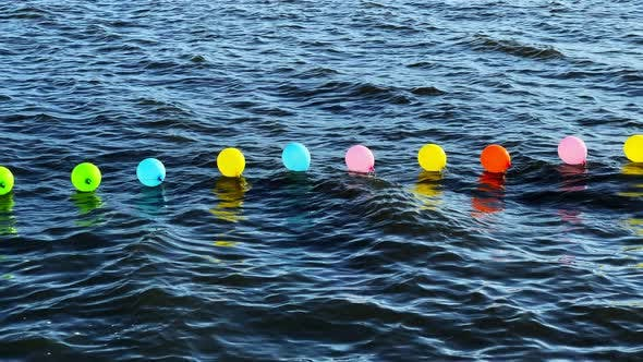 Colorful Balloons In The Sea 1