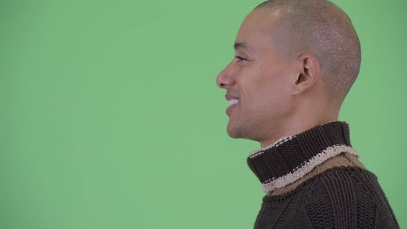 Thumbnail for Closeup Profile View of Happy Bald Multi Ethnic Man Talking Ready for Winter