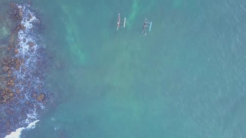 Transparent Ocean Waves Over Sandy Bottom with Seaweed Aerial