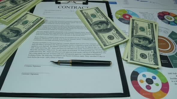 Thumbnail for Financial Business Contract And Money On The Table In The Office Of The Company