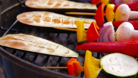 Thumbnail for Vegetables and Mushrooms Roasting on Brazier Grill