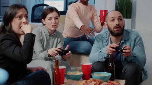 Close Up of Colleagues Playing Video Games on Console