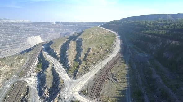 Thumbnail for Aerial Ground Roads for Trucks Meander Around Asbestos Pit