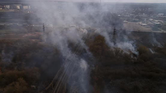 Large Scale Field Fire Near Railroad Traffic On Highway
