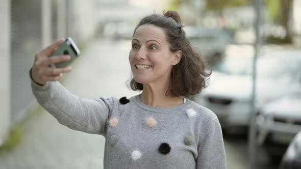 Thumbnail for Happy Middle Aged Woman Having Video Call Through Phone