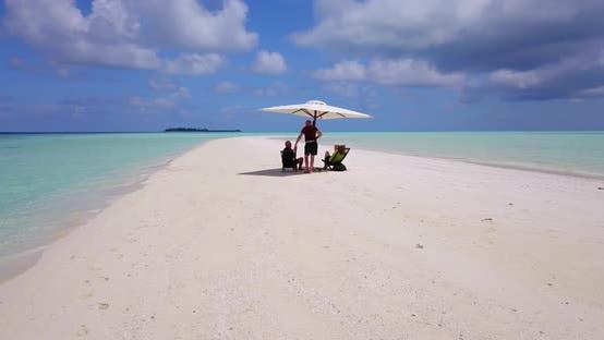 Thumbnail for Romantic man and woman on romantic honeymoon enjoy luxury on beach on summer white sandy 4K backgrou