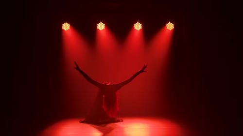 Young Elegant Female Dancer in Black Costume Performing Contemp Choreography in the Smoke of a Dance