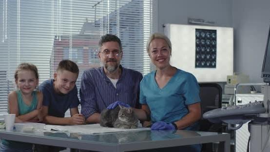 Thumbnail for Female Veterinarian Fondling Cat