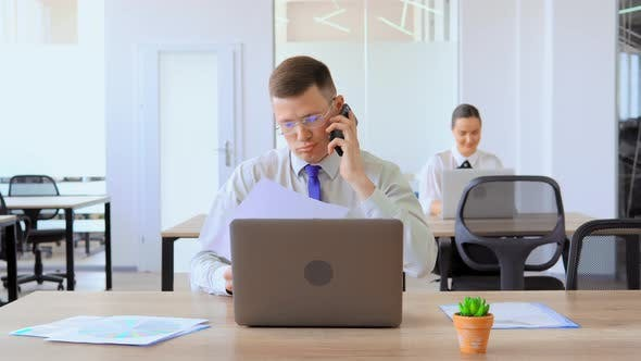 Cover Image for Frustrated Office Worker Is Arguing on Phone