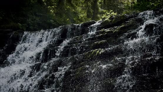 Thumbnail for Stunning Slow Establishing Shot of River with Waterfall in Forest in Summer. Slow Motion V4