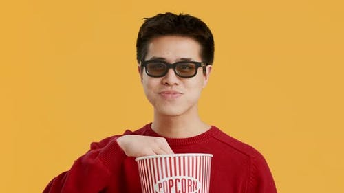 Cheerful Asian Man Wearing 3D Glasses Watching Film Yellow Background