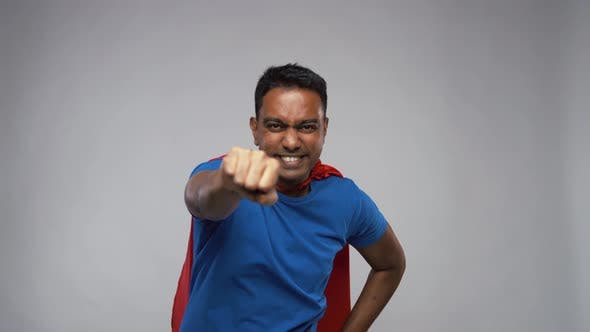 Thumbnail for Indian Man in Superhero Cape Flying Over Grey