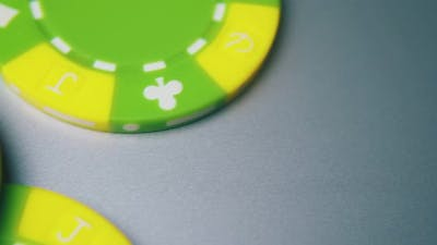 Bright Green Casino Chips for Bets on Light Grey Background