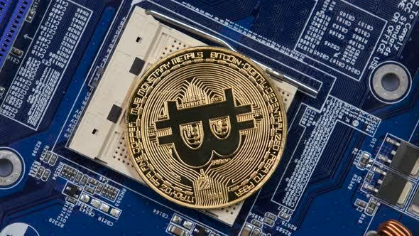 Thumbnail for Gold Bitcoin Virtual Currency on a Motherboard Instead Cpu, New Metal Cryptocurrency Bitcoin