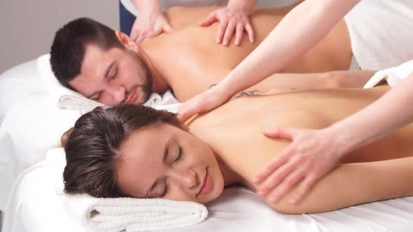 Thumbnail for Beautiful Couple Enjoying Relax Massage in Modern Spa Center