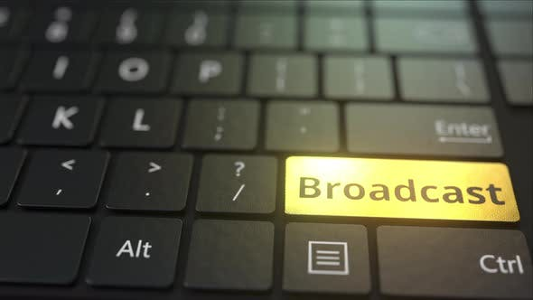 Thumbnail for Black Computer Keyboard and Gold Broadcast Key