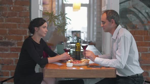 Thumbnail for Romantic Dinner, Couple Drink Wine, Pizza on the Table