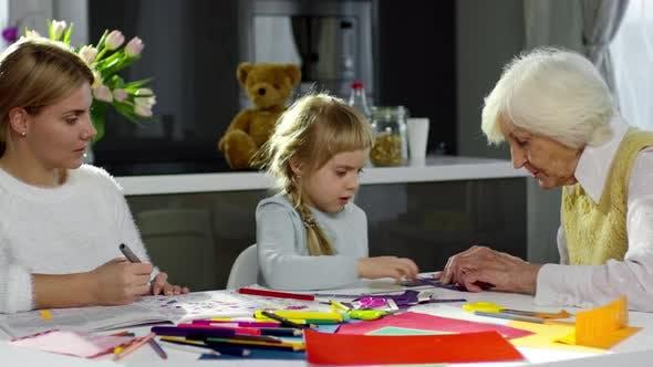 Thumbnail for Girl Doing Origami with Grandma