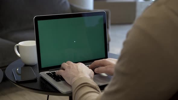 Cover Image for Freelancer Working With Green Screen Laptop