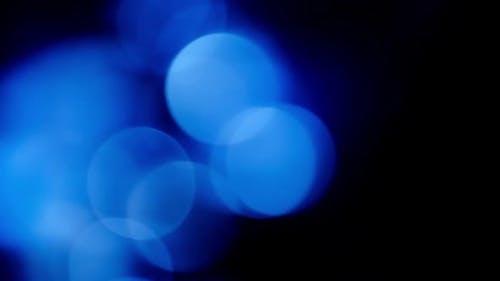 Motion Blur Blue Particles. Background Bokeh