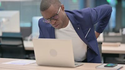 Young African Businessman with Laptop Having Back Pain